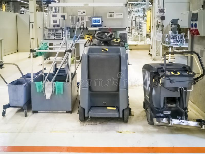 Machines for washing floors in production facilities. Machines for cleaning production facilities stock image