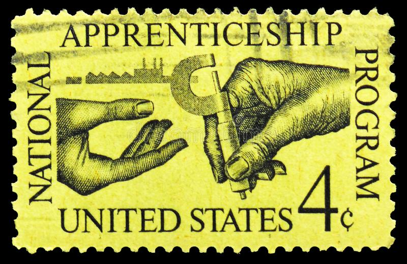 Machinist Handing Micrometer to Apprentice, Apprenticeship Issue serie, circa 1962. MOSCOW, RUSSIA - MARCH 23, 2019: A stamp printed in United States shows royalty free stock photos