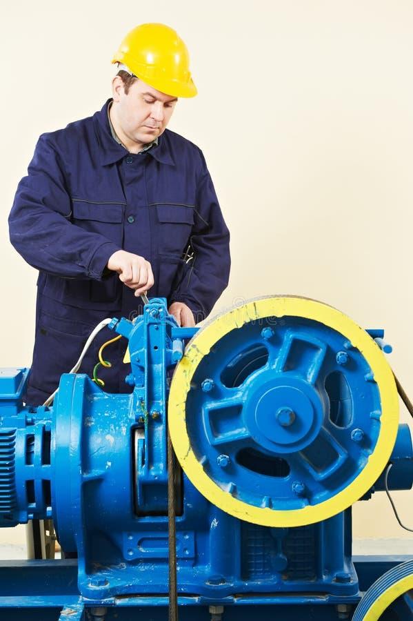 Machinist tuning elevator brakes mechanism stock image