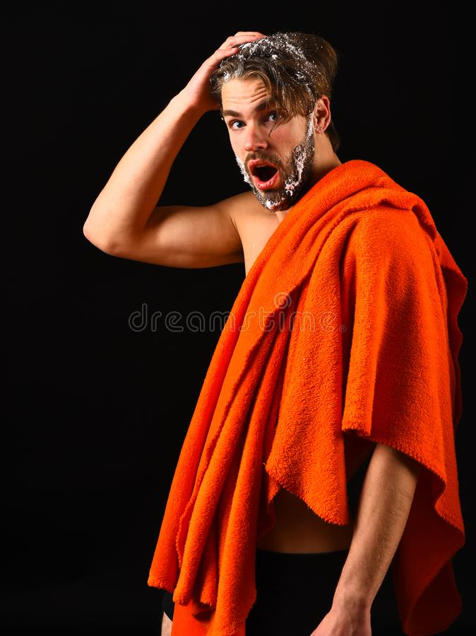 Macho attractive nude guy black background. Man bearded tousled hair covered with foam or soap suds. Wash off foam with. Water carefully. Need take shower. Man stock photos