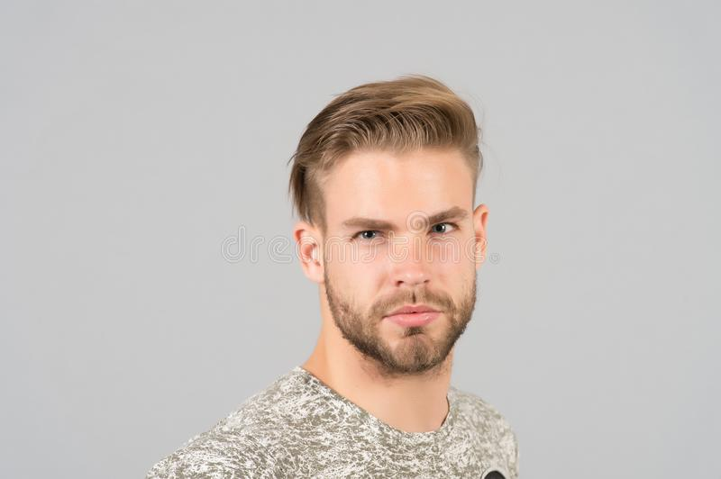Macho with bearded face, beard. Man with blond hair, haircut. Grooming and hair care in beauty salon, barbershop. Fashion, style a. Nd trend concept royalty free stock image
