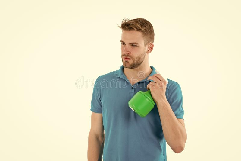 Macho hold plastic spray bottle isolated on white. Man with water sprayer in hand. Sanitary concept. Man strict hold. Spray. Spread out cleaning liquid. Plastic royalty free stock photo