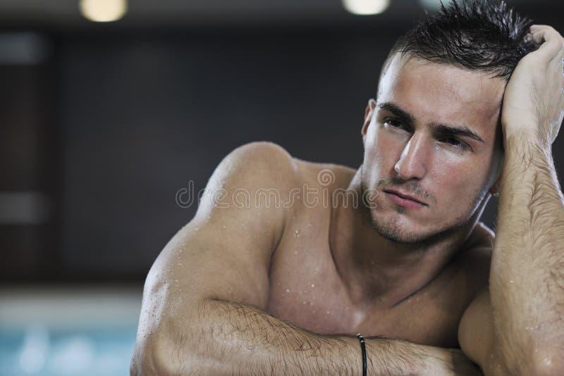 Macho man. Young healthy good looking macho man model athlete at hotel indoor pool stock photos