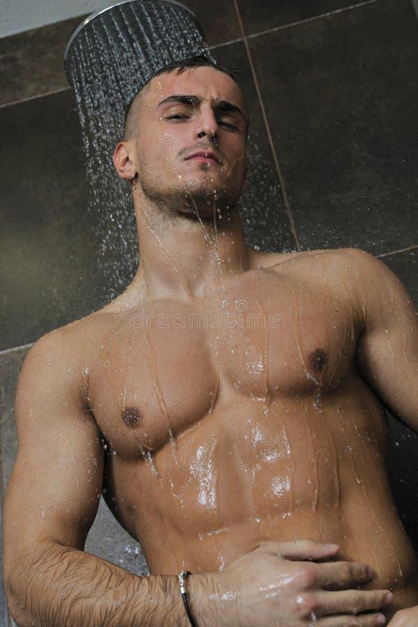 Macho man. Young healthy good looking macho man model athlete at hotel indoor pool royalty free stock image