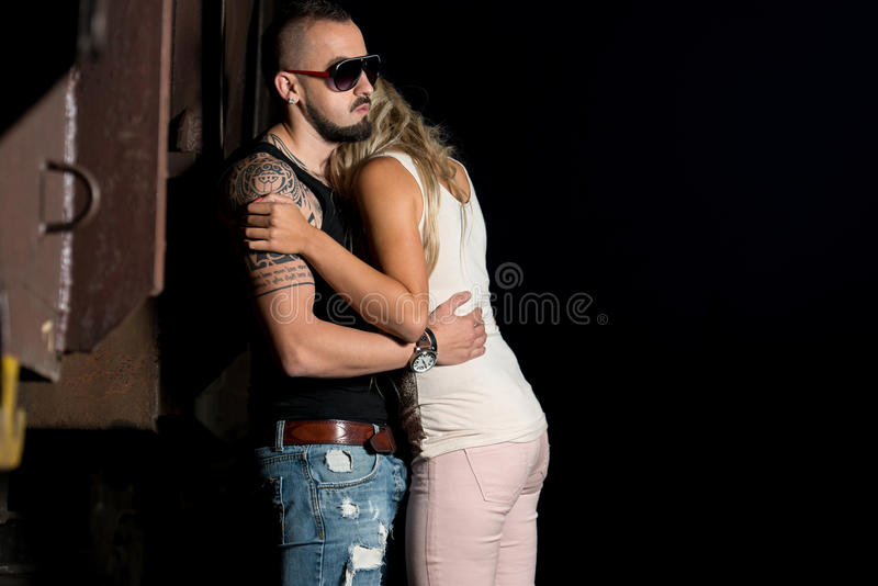 Macho Man Comforting His Girl stock photo