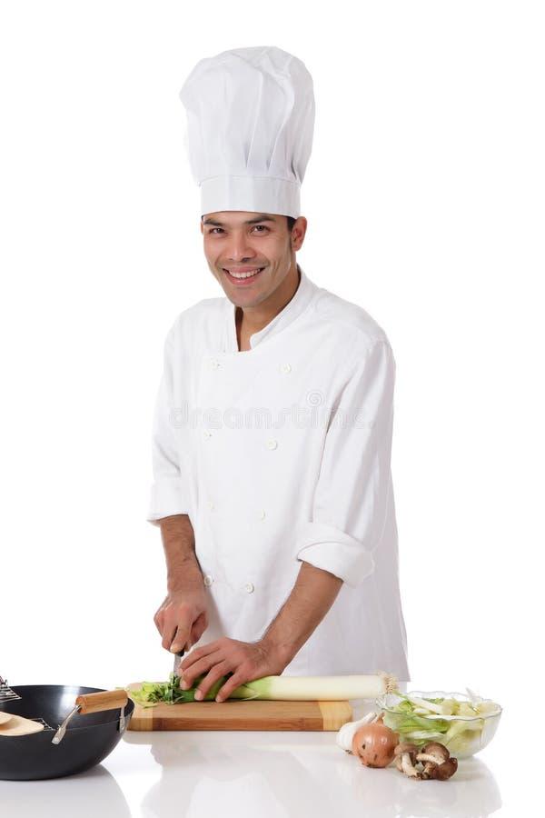 Macho nepalês atrativo do cozinheiro chefe, alho-porro fotos de stock
