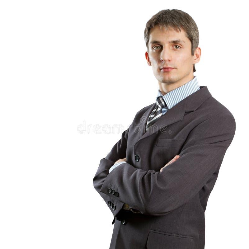 Macho no terno com mãos dobradas foto de stock royalty free