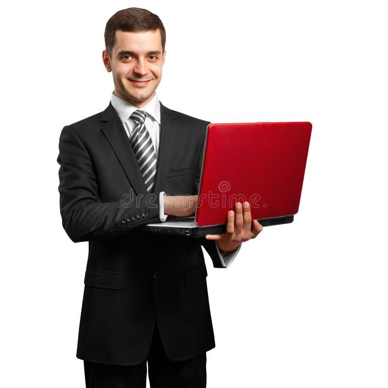 Macho no terno com o portátil em suas mãos foto de stock royalty free