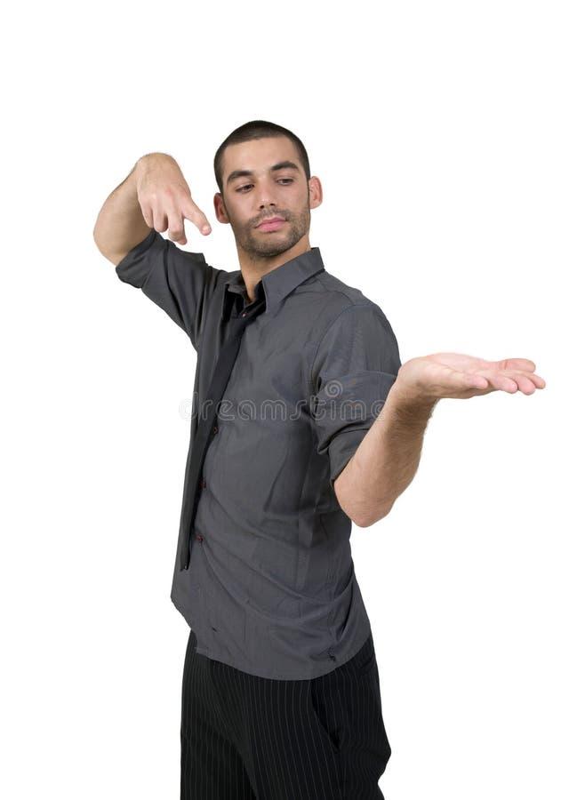 Macho que aponta para sua palma imagem de stock