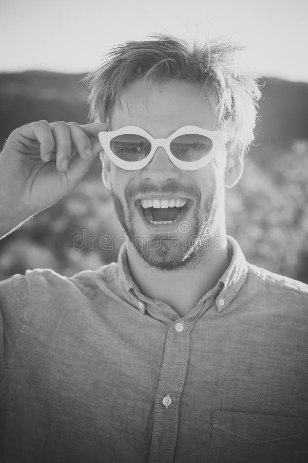 Macho with stylish haircut in funny sunglasses smiling royalty free stock photos