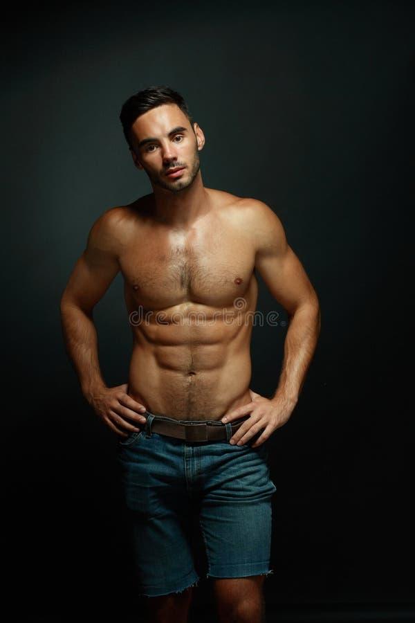 macho topless manstående royaltyfri fotografi