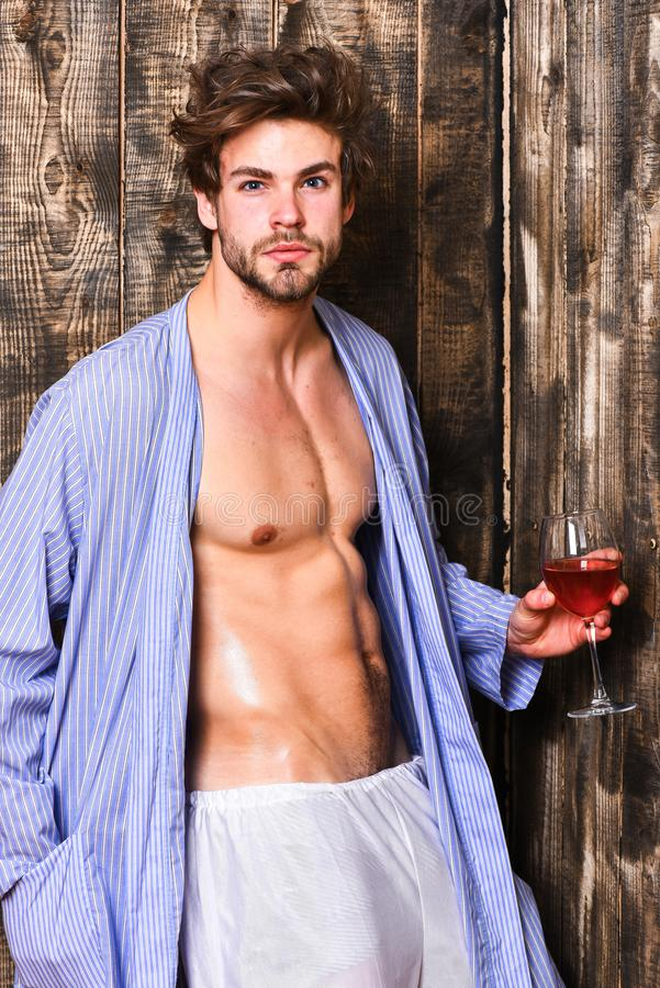 Macho tousled hair degustate luxury wine. Erotic and desire concept. Bachelor enjoy wine. Guy attractive relaxing with. Alcohol drink. Man chest sweaty skin stock photo