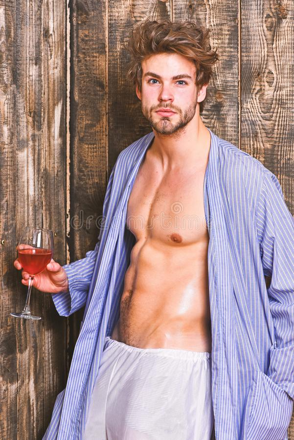 Macho tousled hair degustate luxury wine. Erotic and desire concept. Bachelor enjoy wine. Guy attractive relaxing with. Alcohol drink. Man sexy chest sweaty stock images