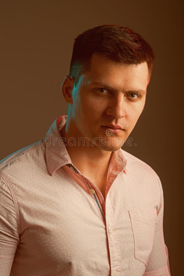 Macho wear fashionable shirt. Man with serious young face. Handsome guy with stylish hair. Youth fashion and style. Concept stock images
