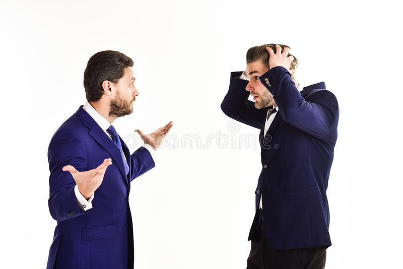 Machos in classic suits have business argument. Unshaven men arg. Ue, isolated on white background. Business controversy concept. Businessman with surprased face royalty free stock photos