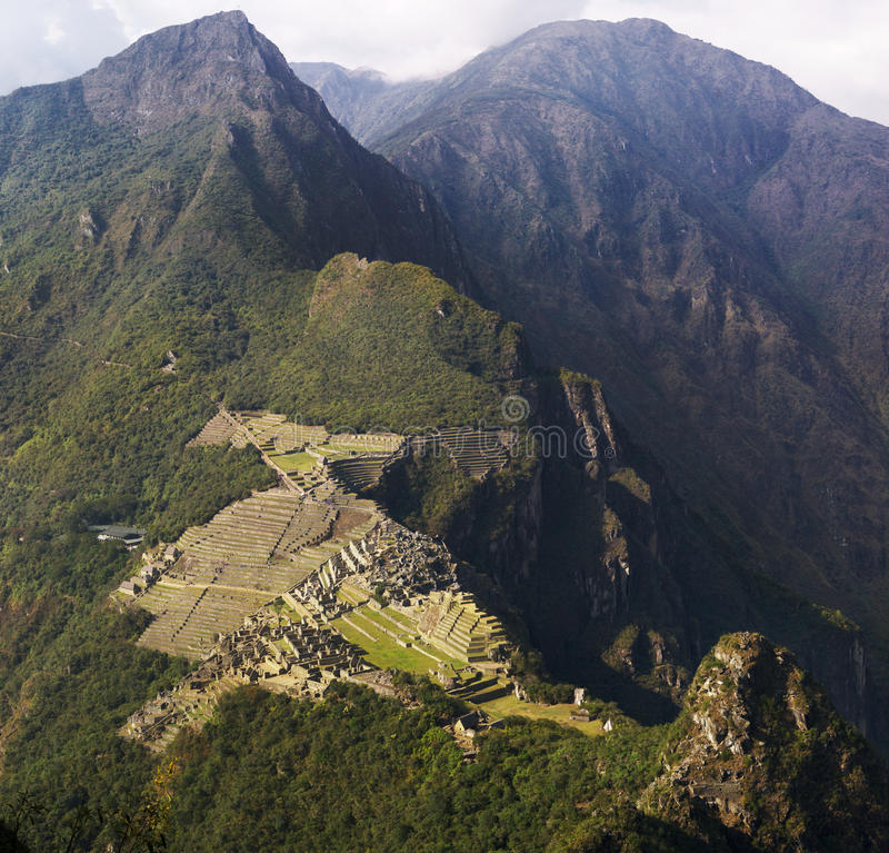 Machu Picchu. And mountains seen from Wayna Picchu, the oposite direction. Slight mist stock photos