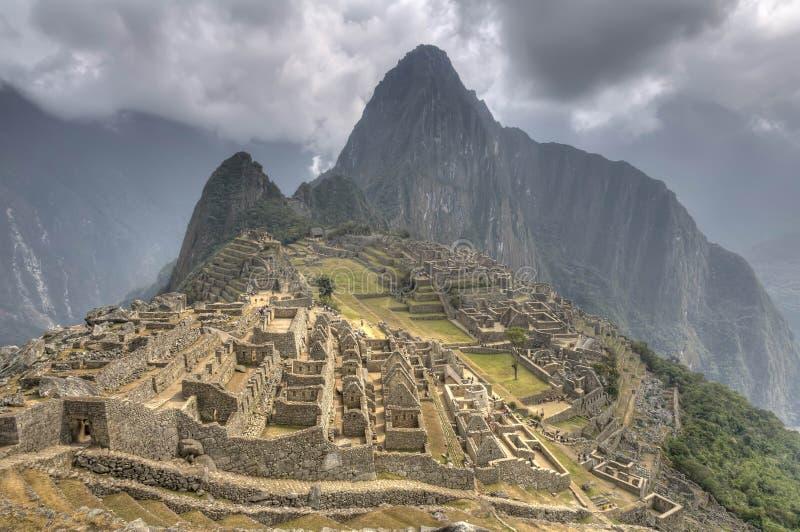 Machu Picchu. The Lost Incan City of Machu Picchu under dramatic sky, Peru stock images