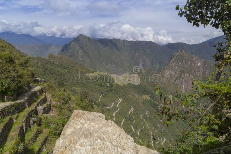 Machu Picchu and Huayna Picchu mountain in Peru, seen from the door of the sun. Background, cusco, tree, cloud, forest, culture, america, landmark stock photo