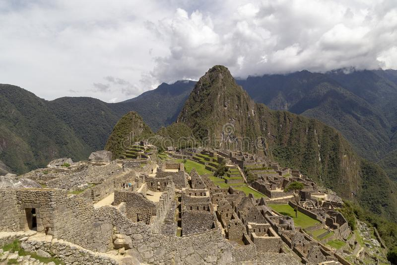 Machu Picchu and Huayna Picchu mountain in Peru, seen from the door of the sun. Background, cusco, tree, cloud, forest, culture, america, landmark royalty free stock image