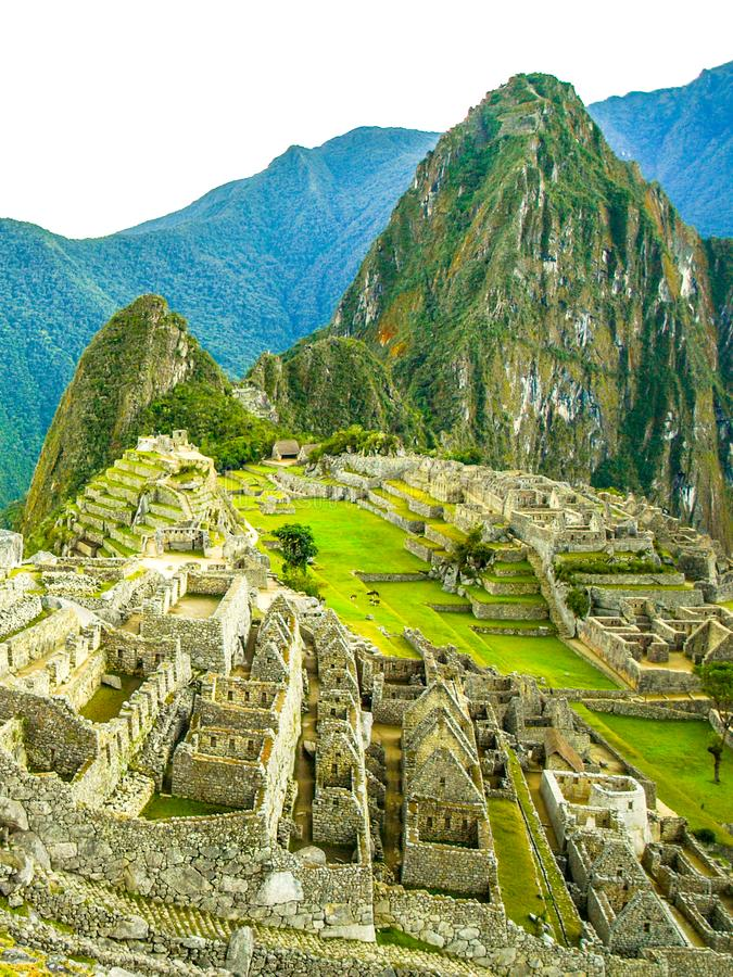 Machu Picchu - lost city of Incas. Historical citadel above Sacred Valley with Urubamba River in Peru royalty free stock image