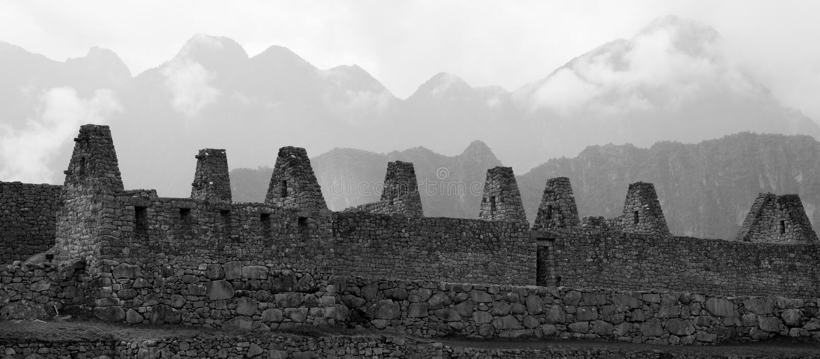 Machu Picchu, magical black and white. Great wall under mountains, fog and the energy from the region stock image
