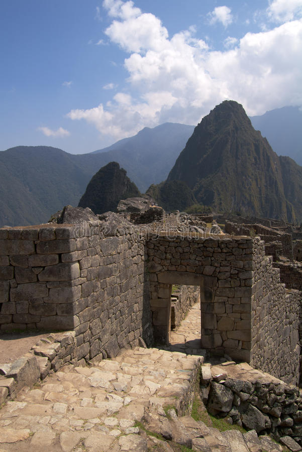 Machu Picchu main gate. The main entrance gate to Machu Picchu seen from the outside. Wayna Picchu in the background royalty free stock image