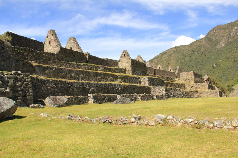 Machu Picchu overview. Machu Picchu is a 15th-century Inca citadel situated on a mountain ridge 2,430 metres (7,970 ft) above sea level. It is located in the stock photos