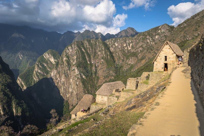 Machu Picchu, Peru - 3 de agosto de 2017: Ruínas antigas do PIC de Machu fotografia de stock