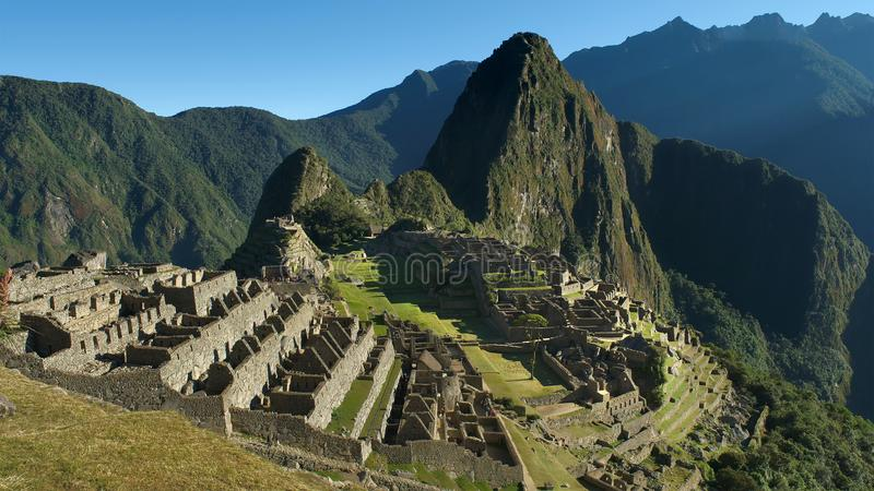 Machu Picchu in Peru - lost city of Incan Empire is UNESCO heritage. Sunny summer day with blue sky. stock photography