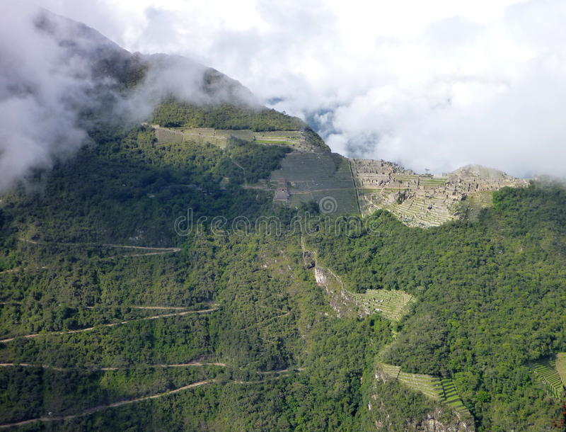 Machu picchu seen from oposite mountain putucusi. The machu picchu seen from oposite mountain putucusi stock images