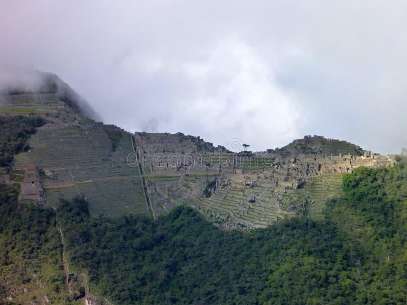 Machu picchu seen from oposite mountain putucusi. The machu picchu seen from oposite mountain putucusi stock photo