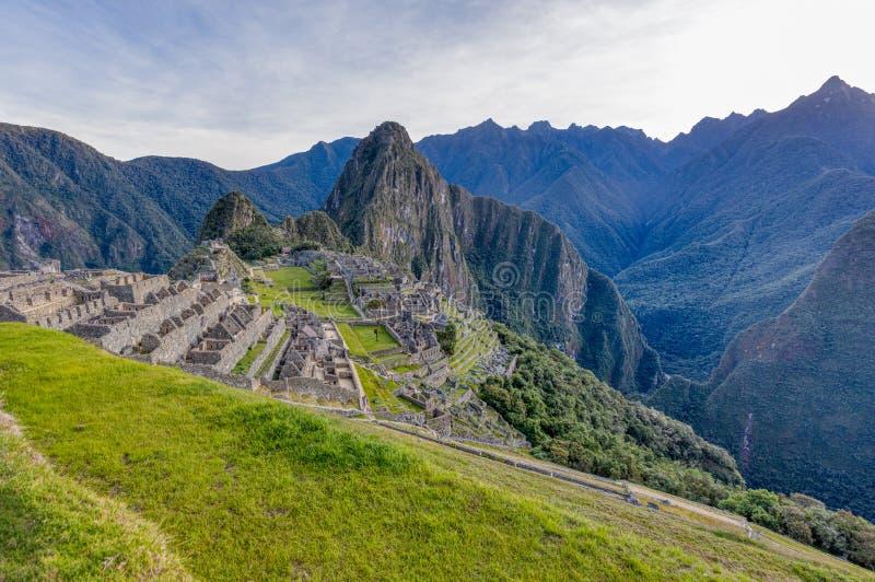 Machu Picchu situado na região de Cusco de Peru fotografia de stock royalty free