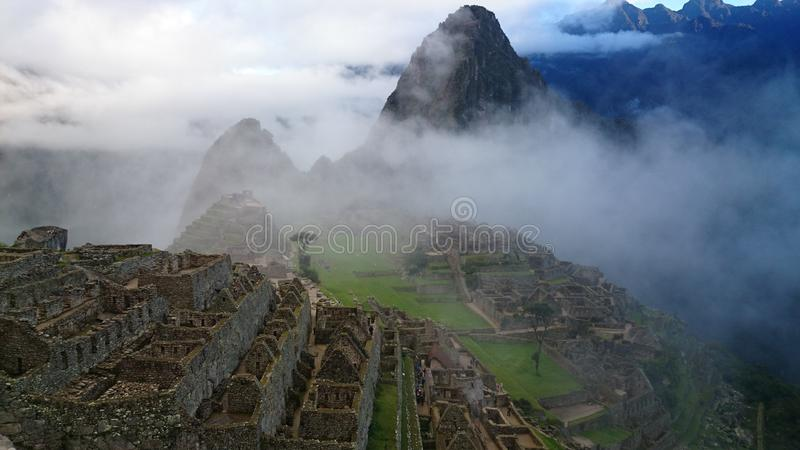 Machu Pichu. Early morning hidden by clouds stock images