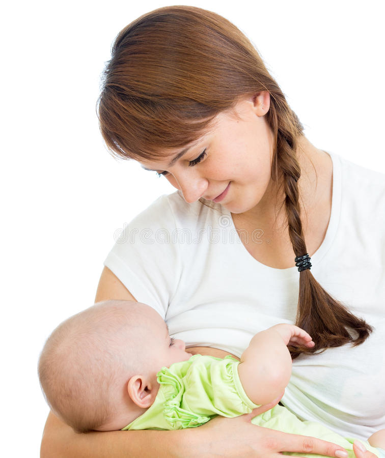 Macierzysta pierś - karmiący jej dziecka i ściskający fotografia royalty free