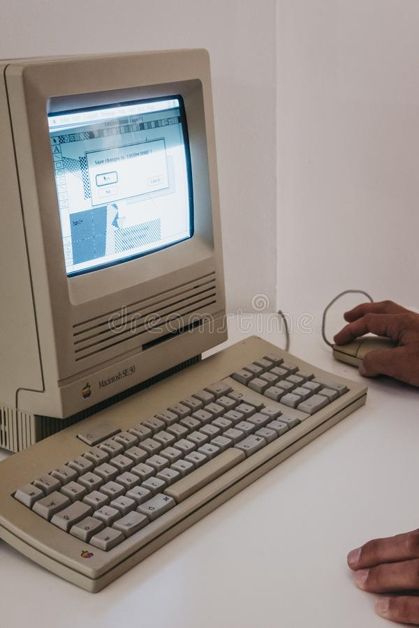 Macintosh SE30 computer on display inside Apple Museum in Prague, Czech Republic. Prague, Czech Republic - August 28, 2018: Macintosh SE30 computer on display royalty free stock photos
