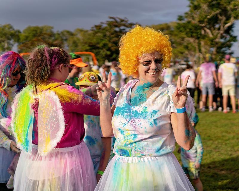 Happy Woman In Orange Wig At Color Frenzy Fun Run stock images