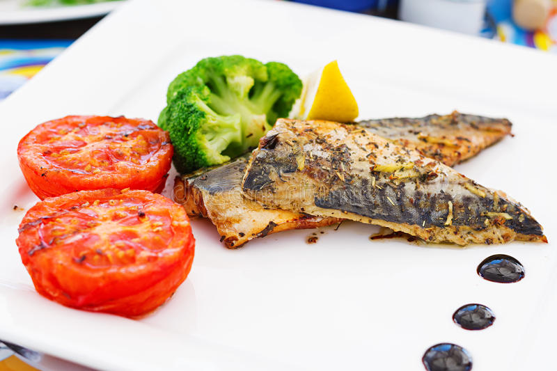 Mackerel fillets (fish) on a grill royalty free stock photography