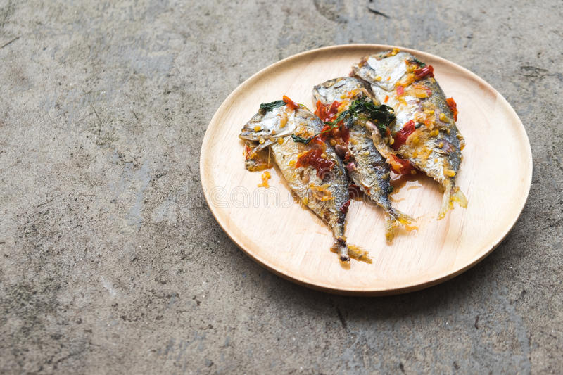 Mackerel serve with sauce. In wooden plate stock photo