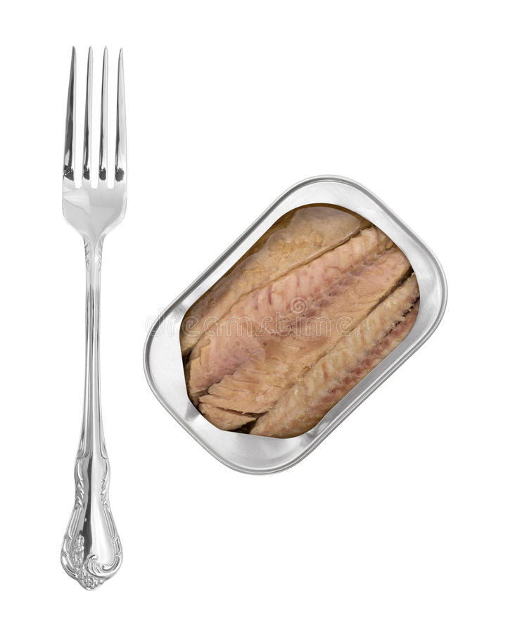 Mackerel skinless fillets with olive oil in a tin. Top view of skinless mackerel fillets in olive oil in an opened tin with a fork to the side royalty free stock photo