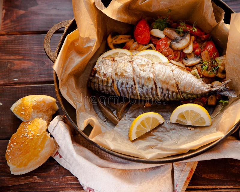 Mackerel with vegetables stock image