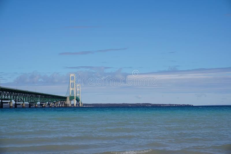 Mackinac Bridge with blue sky and clouds stock images
