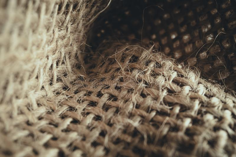 Macro view of natural linen fabric texture for background. Soft lights royalty free stock image
