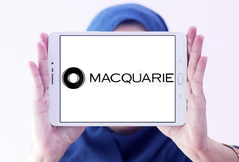 Macquarie financial services Group logo. Logo of Macquarie Group on samsung tablet holded by arab muslim woman. Macquarie is a global investment banking and stock photography