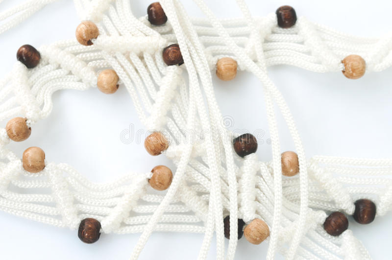 Macrame with wooden beads royalty free stock photo
