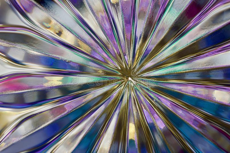 Macro abstract art background of beautiful lead crystal glass reflecting brilliant purple color stock image