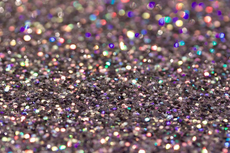 Macro abstract art background of bright silver glitter texture stock photography