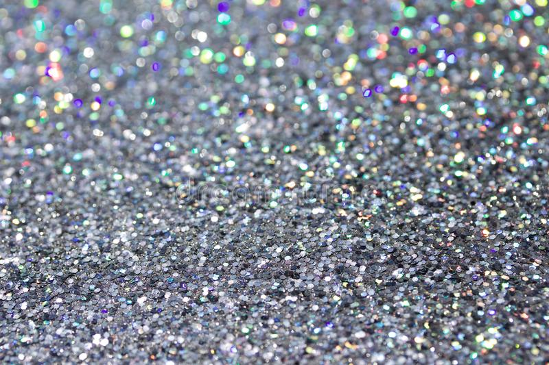 Macro abstract art background of bright silver glitter texture stock images