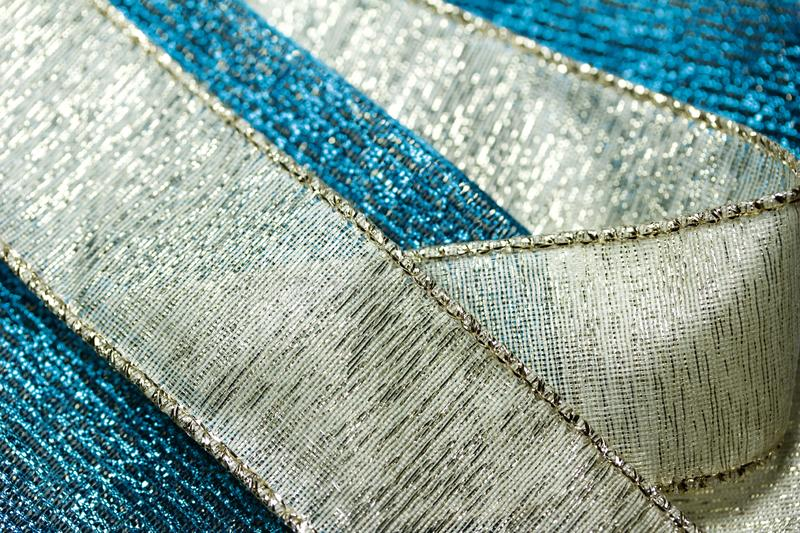 Macro abstract art texture background of sparkling gold and blue metallic wire cloth ribbons royalty free stock image