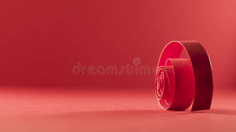 Macro, abstract, background picture of red paper spirals. On paper background stock photos