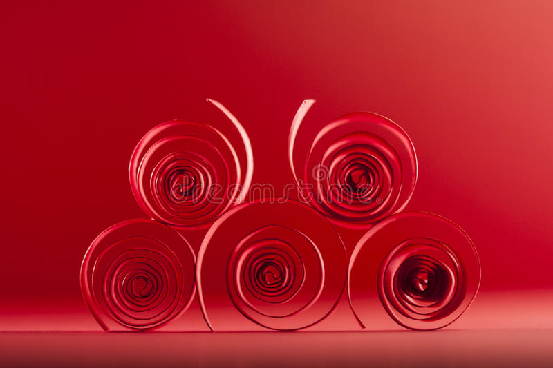 Macro, abstract, background picture of red paper spirals. On paper background royalty free stock photos